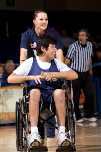 HoopStars player in a wheelchair on the basketball court.