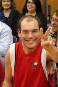 HoopStar player giving a peace sign.